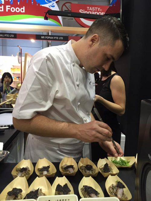 Chef Brendon Partridge cooking NZ scampi risotto at NZTE stand at FHA2016