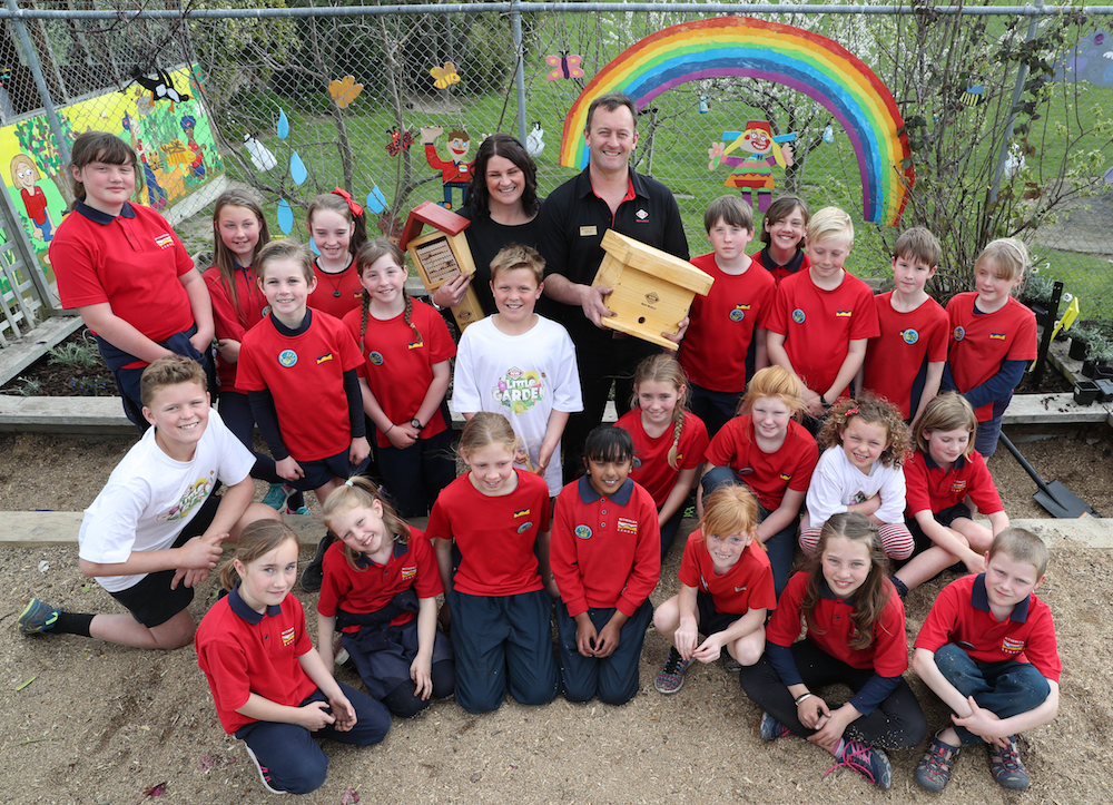 Melanie and Ashley Shore from New World Blenheim with the donated Leafcutter beehive, and bumblebee house, pictured with enviro students at Witherlea School in Blenheim.