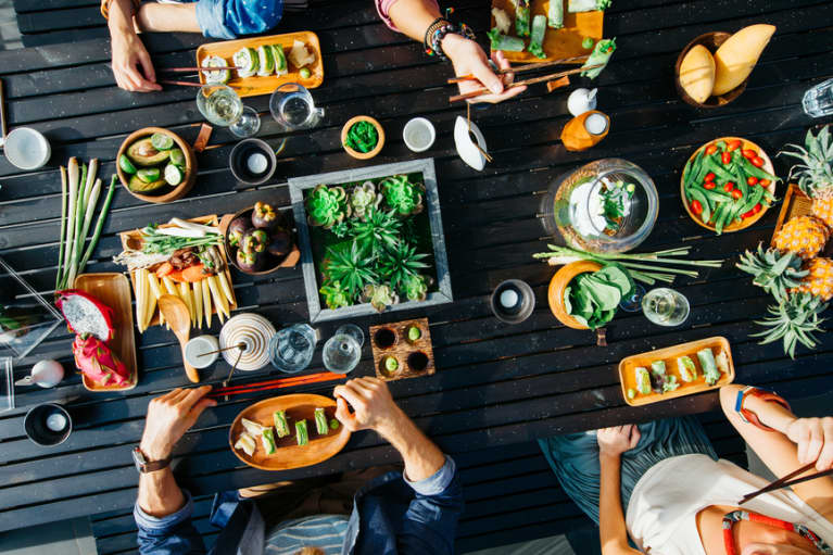Diners at table eating plant-based meal