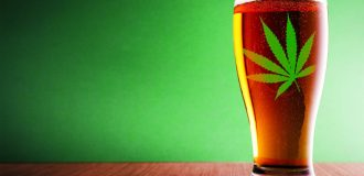 beer in a glass with a marijuana leaf on it