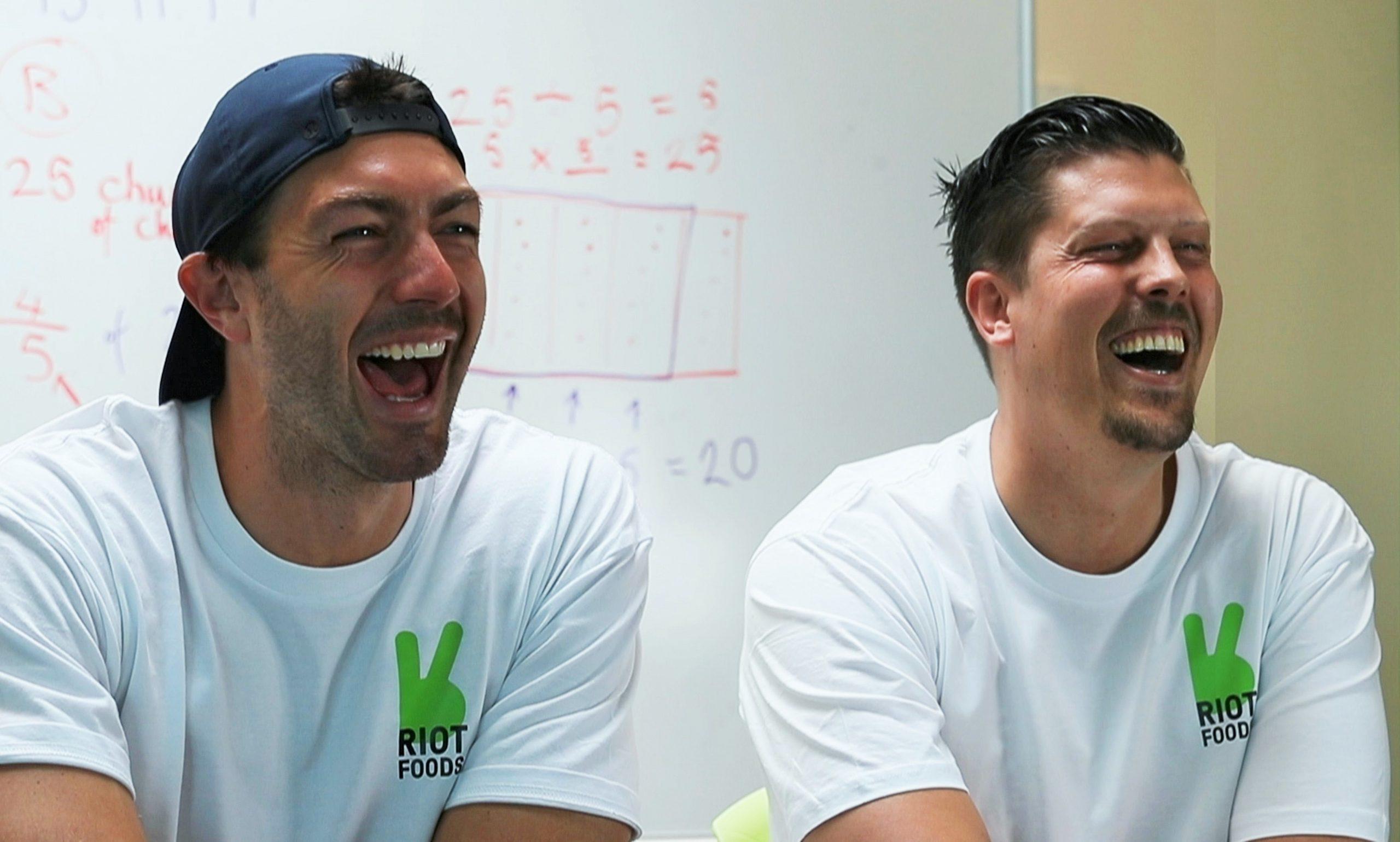 art green and ryan kamins laugh together