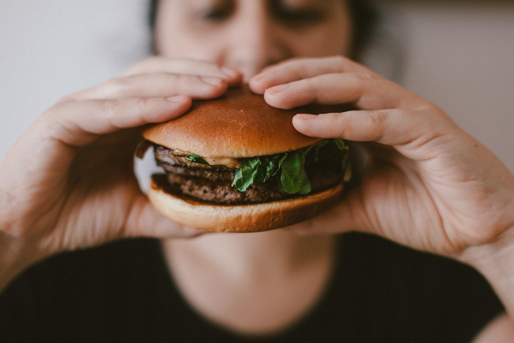 Vegan burger held by two hands