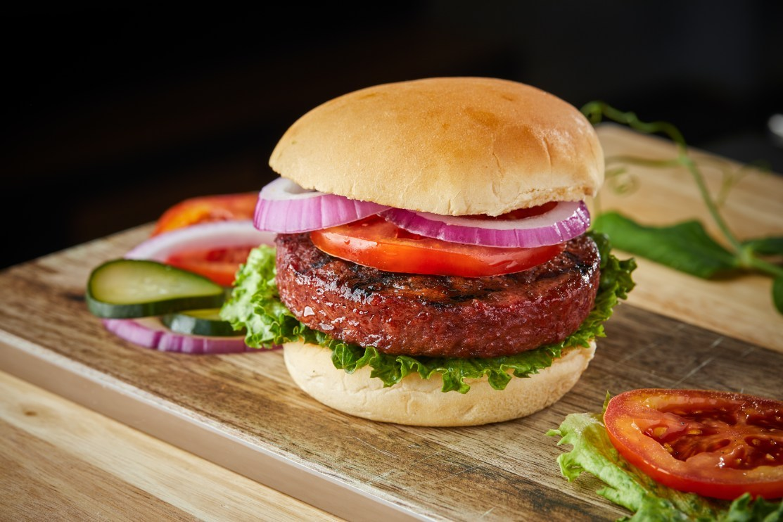 Sweet Earth Foods Awesome Burger in wooden chopping board