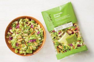 Avocado salad kit pack next to a salad bowl