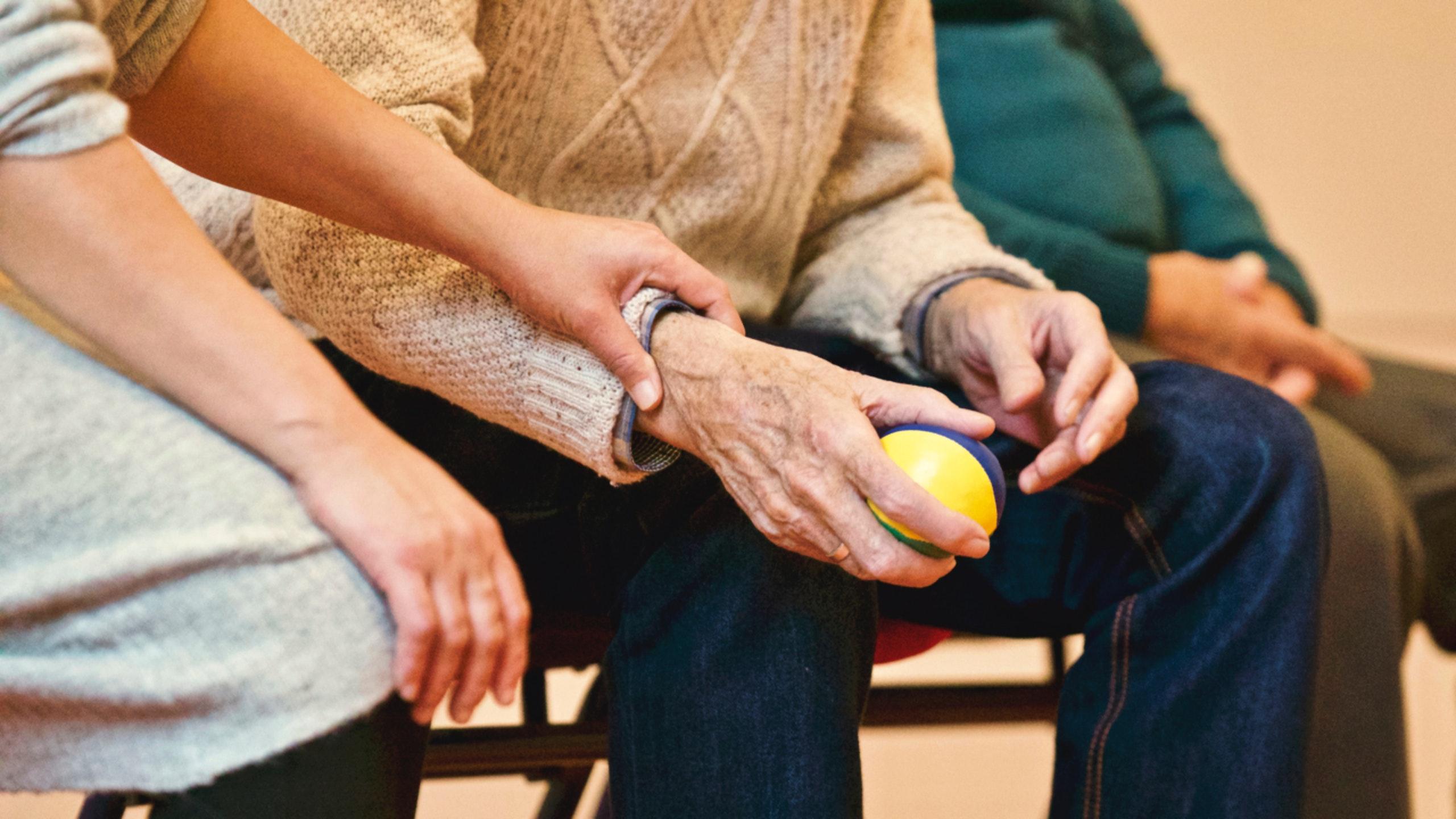 Elderly hand holding a stress ball