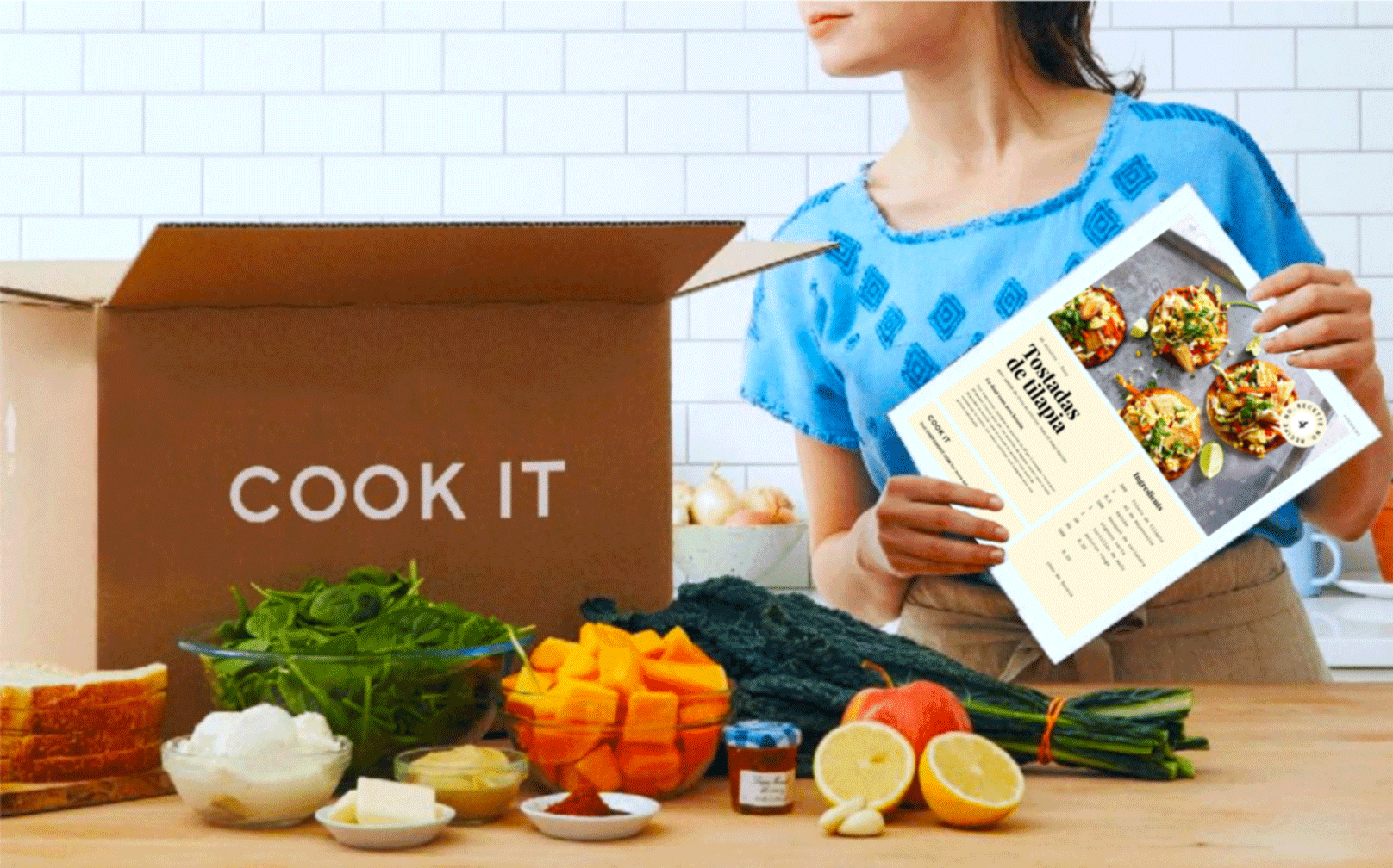 CookIt box with vegetables and woman holding recipe note