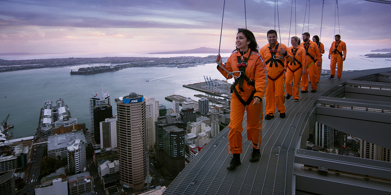 Sky Tower 360 Sky walkers on the edge of Sky Tower rim