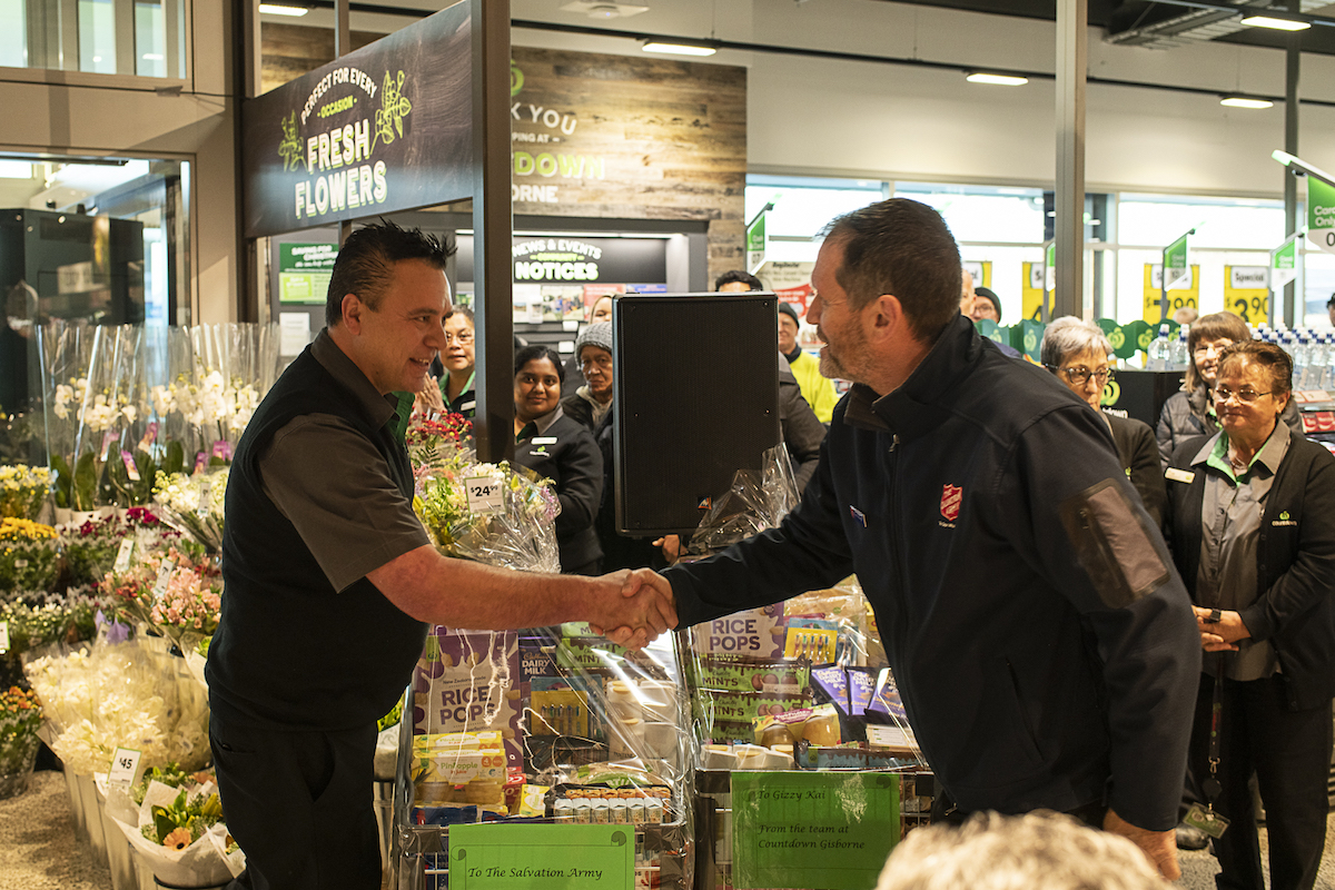 Countdown Gisborne Store Manager Jess Stubbs gives trolley of food to Salvation Army's Kevin Waugh